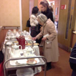 Families and loved ones enjoying the cream tea after the remembrance service