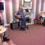 Chris Clarke entertaining Immacolata House on National Smile Day