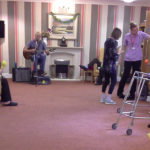 Staff and residents having fun on National Smile Day with Chris Clarke's live music