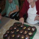 Clarence Park resident decorating the Easter cakes