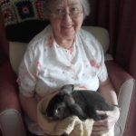 Casa di Lusso resident holding Alice - rabbit