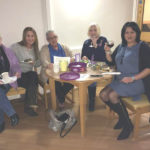 residents, loved ones and staff enjoying the cheese and wine evening