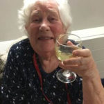 Resident enjoying a glass of wine