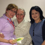 staff, resident and loved one during the cheese and wine evening