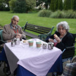 Residents enjoying a cream tea in Clarence Park
