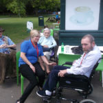 Residents and staff enjoying the sunshine in Clarence Park