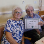 Resident & loved one with their award certificate