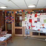 Immacolata House reception decorated in British flag bunting and flag of Prince Harry & Meghan