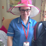 Immacolata House staff member wearing a hat for the wedding of Prince Harry & Meghan