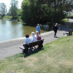 Residents sat on the bench in the sunshine at Apex Park