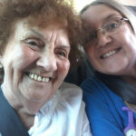 Resident with Ruth, Activities Coordinator, in the mini bus