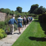 Immacolata House residents walking in the gardens of Lytes Cary Manor