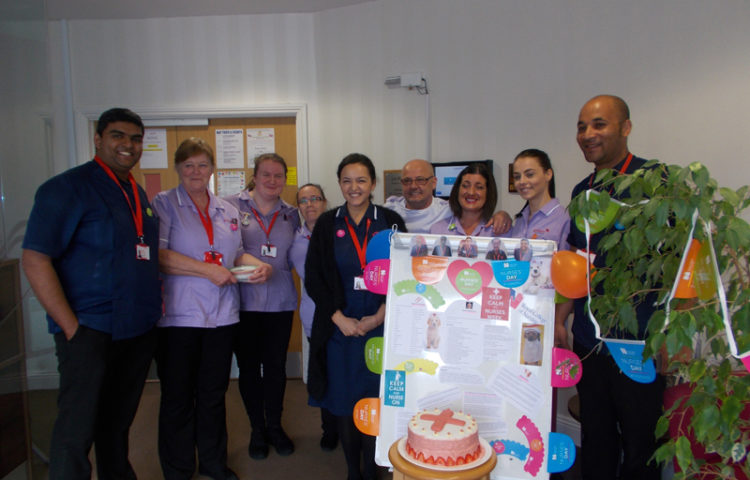 La Fontana Nurses with their care team behind the International Nurses Day display board, decorations and their home made celebratory cake