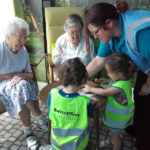 Residents making playdough shapes with the nursery children