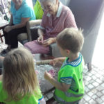 Residents making playdough shapes with the Butterflies nursery children