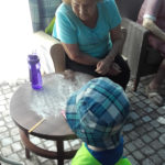 Resident making playdough shapes with nursery child