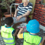 Resident making playdough shapes with the nursery children