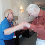 Activities coordinator dancing with resident