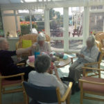 residents knitting baby blankets at their knit n natter club, Immacolata House Dementia Care Home, Langport