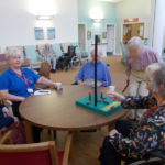 Residents playing table top bowling