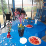 The table laid with glasses, jug of Pimms and fresh strawberries with pots of cream at La Fontana Dementia Nursing Home Martock
