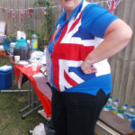 Shona, Activities Assistant wearing British flag waistcoat at La Fontana Dementia Care Homes Party in the garden