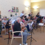 The Yeovil Ukulele Club entertaining residents and loved ones at La Fontana