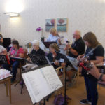 The Yeovil Ukulele Club entertaining residents and loved ones at La Fontana during their August Activities