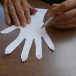 La Fontana Care Home Resident colouring in her left hand picture
