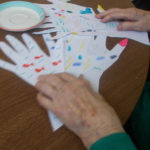 La Fontana Care Home Resident looking at the finished Left Hand pictures