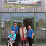 Immacolata House residents and activities team outside Glenda Spooner Farm
