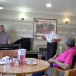 Immacolata House care home resident dancing to live music from Matt Rock
