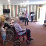 Immacolata House care home resident dancing and singing along with John and The General