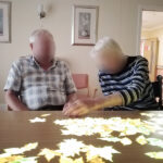 Immacolata House care home residents sweeping away the leaves on the Tovertafel