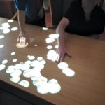 Immacolata House care home residents playing with the interactive magic table