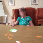Immacolata House care home resident playing with the interactive magic table