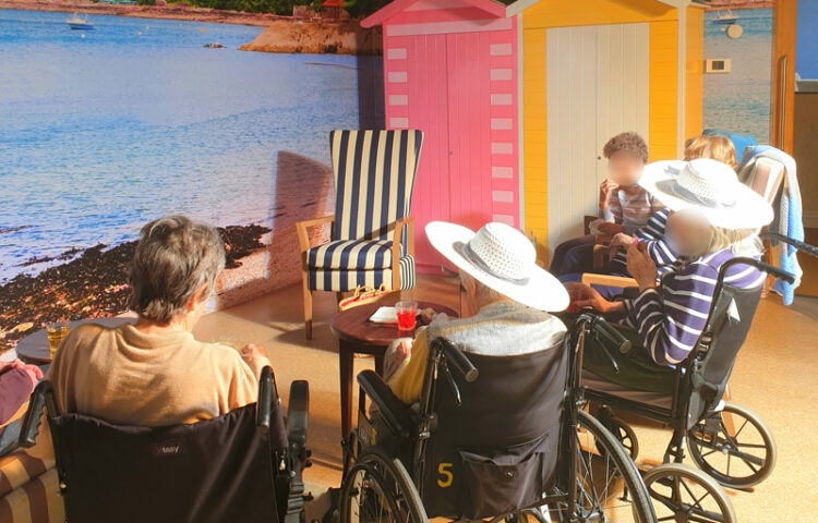 Residents at La Fontana Care Home, basking in the sunshine on their own beach sun room