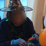 Casa di Lusso Care Home resident getting messy removing the inside of her pumpkin