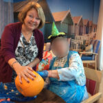 Casa di Lusso Care Home resident & loved one getting messy removing the inside of a pumpkin