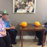 Casa di Lusso residents and staff dressed for halloween with their finished spooky pumpkins