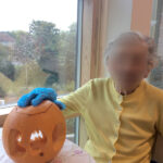 Casa di Lusso care home resident sat with her finished carved pumpkin