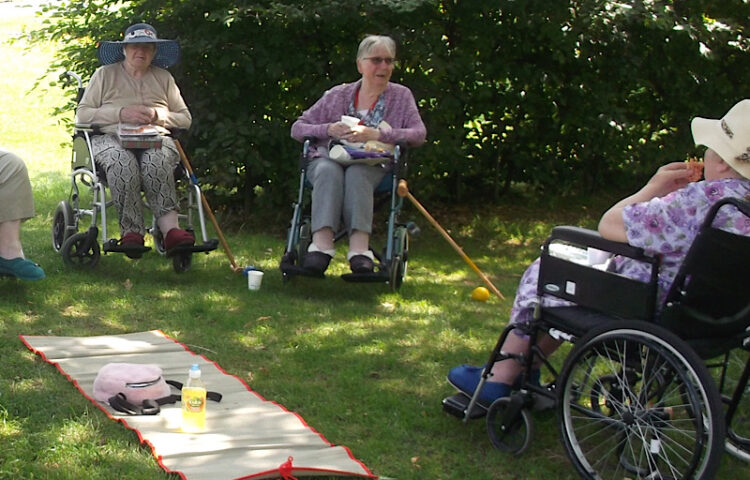 Clarence Park residents in the park with the Church Club