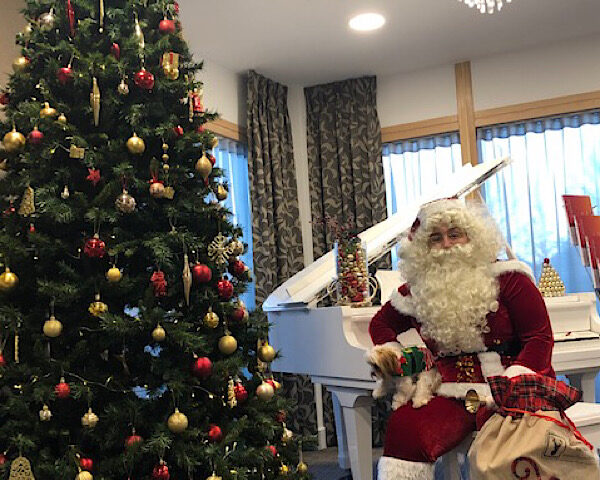 Father Christmas and 'his' four legged Elf at Casa di Lusso Care Home Bridgwater