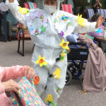 Casa di Lusso staff member in her Easter inspired costume during the fashion show