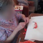 Casa di Lusso resident making a costume for their social distancing garden party fashion show