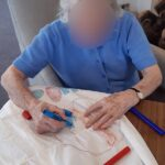 Casa di Lusso resident making a costume for the garden party fashion show
