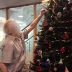 Casa di Lusso resident hanging decorations on the tree