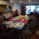 Serenita residents making homemade decorations