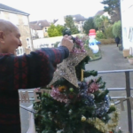 Clarence Park resident putting the star on the tree